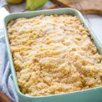 Pear Streusel Cake in green pan with powdered sugar…