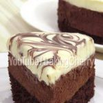 Double Chocolate Mousse Cake Recipe. A rich and chocolaty dessert, made with a f…
